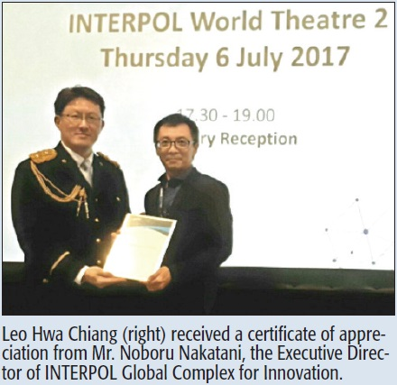 Leo Hwa Chiang (right) received a certificate of appreciation from Mr. Noboru Nakatani, the Executive Director of INTERPOL Global Complex for Innovation.